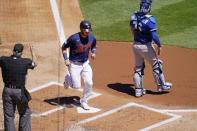 Minnesota Twins' Josh Donaldson scores on a ground-rule double by Nelson Cruz in the first inning of a baseball game against the Kansas City Royals, Saturday, May 29, 2021, in Minneapolis. It was the 2 millionth run scored in Major League Baseball history, according to Elias Sports Bureau. (AP Photo/Jim Mone)