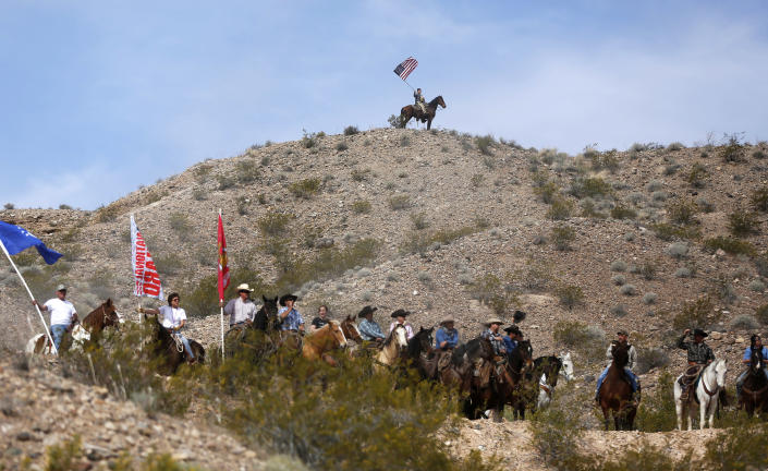 Protesters on horseback ride on the hills above a rally site in Bunkerville, Nev., April 12, 2014. (Photo: Jim Urquhart/Reuters)