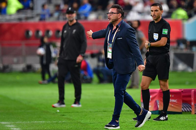Monterrey's coach Antonio Mohamed (C) points at Liverpool's German manager Jurgen Klopp (L) during the 2019 FIFA Club World Cup semi-final football match between Mexico's Monterrey and England's Liverpool at the Khalifa International Stadium in the Qatari capital Doha on December 18, 2019. (Photo by Giuseppe CACACE / AFP) (Photo by GIUSEPPE CACACE/AFP via Getty Images)