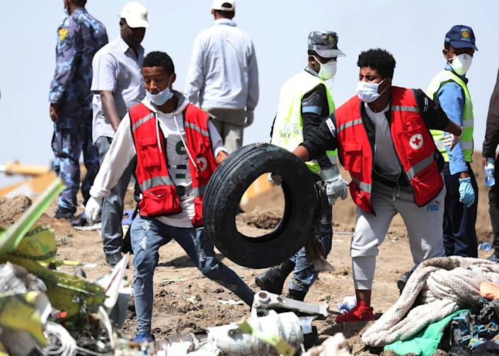 Search workers carry a tyre at the scene of the Ethiopian Airlines Flight ET 302 plane crash, near the town of Bishoftu, southeast of Addis Ababa, Ethiopia March 11, 2019. (Photo: Tiksa Negeri/Reuters)