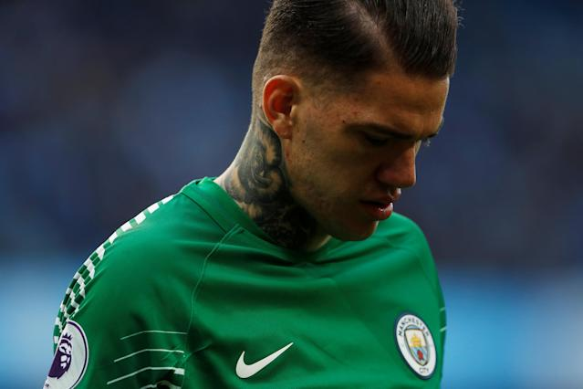 """Soccer Football - Premier League - Manchester City v Swansea City - Etihad Stadium, Manchester, Britain - April 22, 2018 Manchester City's Ederson Action Images via Reuters/Lee Smith EDITORIAL USE ONLY. No use with unauthorized audio, video, data, fixture lists, club/league logos or """"live"""" services. Online in-match use limited to 75 images, no video emulation. No use in betting, games or single club/league/player publications. Please contact your account representative for further details."""