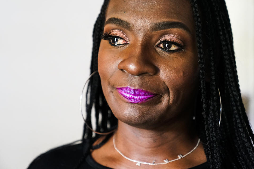 In this July 8, 2021., photo a tear forms in Latrice Felix's eye whose son Alan Womack Jr. was was killed in 2020 during a fight, during an interview with The Associated Press in King of Prussia, Pa. (AP Photo/Matt Rourke)
