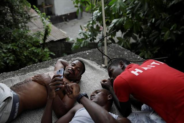 The Wider Image: Haiti's cyclists brave protests and poor roads in race for gold