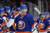 New York Islanders' Anthony Beauvillier celebrates with teammates after scoring a goal during the third period of Game 3 of an NHL hockey Stanley Cup first-round playoff series against the Pittsburgh Penguins on Thursday, May 20, 2021, in Uniondale, N.Y. The Penguins won 5-4. (AP Photo/Frank Franklin II)
