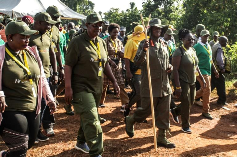 Ugandan President Yoweri Museveni and veterans and Members of Parliament, march through the jungle as he retraces the route which his guerrilla forces took 35 years ago (AFP Photo/Hajarah Nalwadda)
