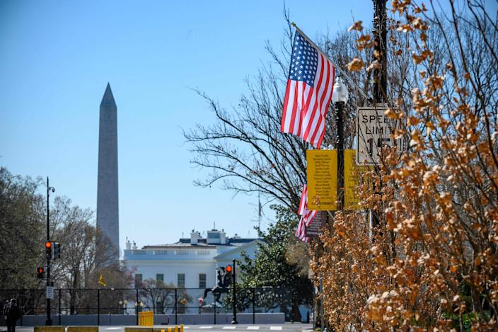 <p>The Stars and Stripes hangs over Black Lives Matter Plaza in Washington DC –with an extra star symbolising the ambition of making the District of Columbia the 51st state of the USA</p> (AFP via Getty Images)