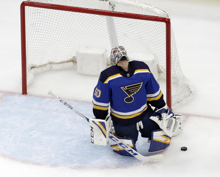 St. Louis Blues goaltender Jordan Binnington reacts after giving up a goal to Winnipeg Jets' Patrik Laine, of Finland, during the second period in Game 3 of an NHL first-round hockey playoff series Sunday, April 14, 2019, in St. Louis. (AP Photo/Jeff Roberson)