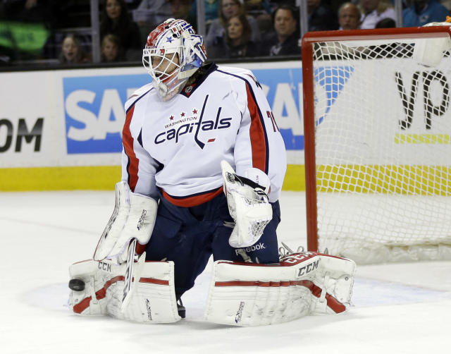 Washington Capitals goalie Braden Holtby stops a shot by the San Jose Sharks during the first period of an NHL hockey game on Saturday, March 22, 2014, in San Jose, Calif. (AP Photo/Marcio Jose Sanchez)