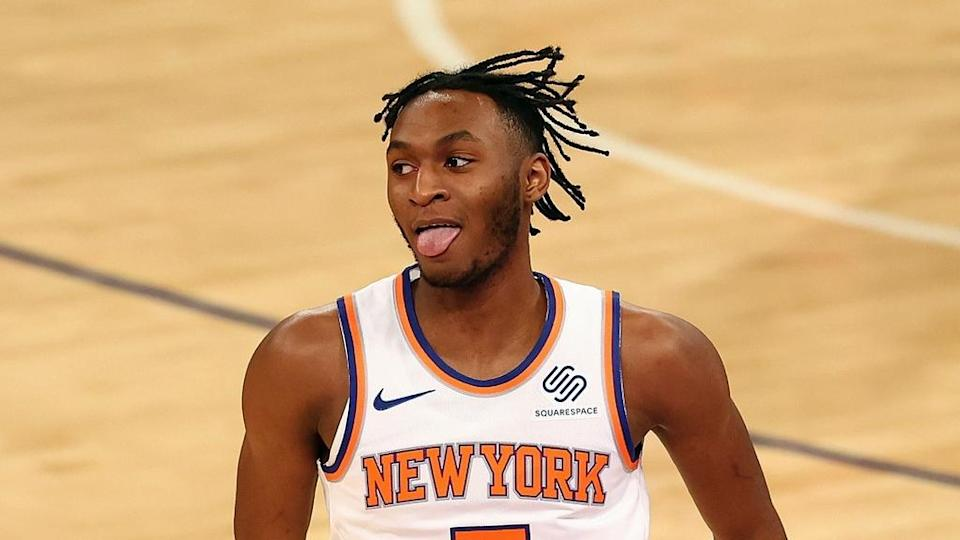 Mar 29, 2021; New York, New York, USA; New York Knicks guard Immanuel Quickley (5) reacts after hitting a three point basket against the Miami Heat at Madison Square Garden.