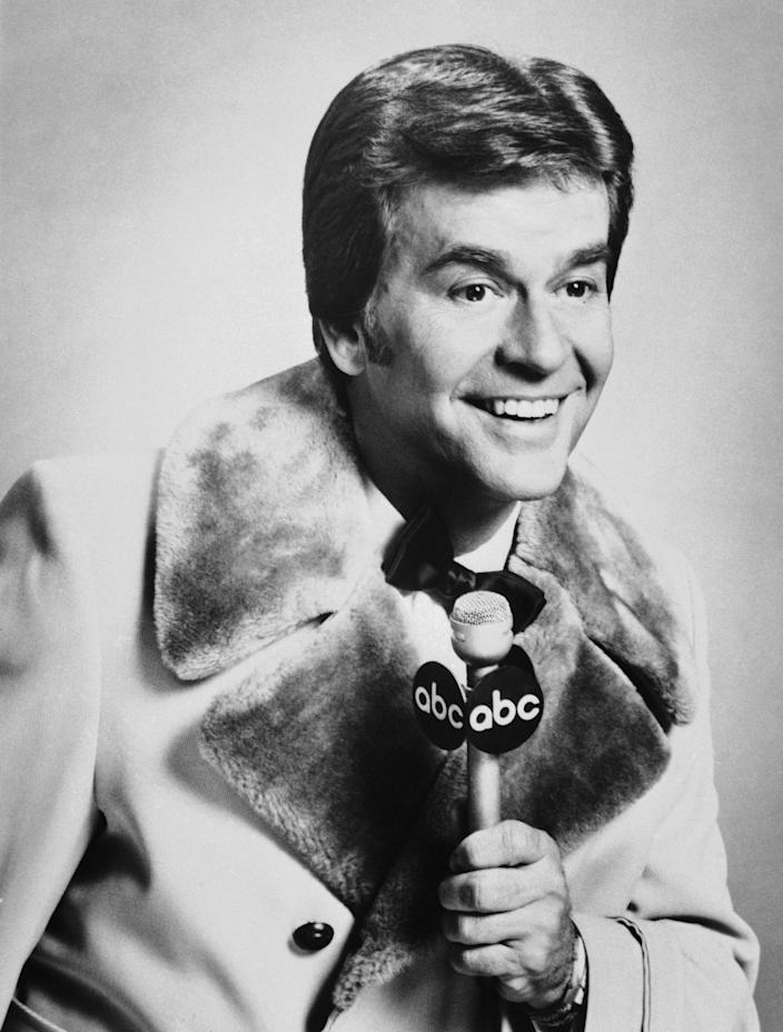"""FILE - In this Dec. 1980 file photo released by ABC, Dick Clark is shown. Clark, the television host who helped bring rock `n' roll into the mainstream on """"American Bandstand,"""" has died. He was 82. Spokesman Paul Shefrin says Clark died but did not provide further details. Clark had continued performing even after he suffered a stroke in 2004 that affected his ability to speak and walk. (AP Photo/File)"""