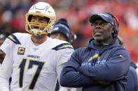 FILE - In this Sunday, Dec. 29, 2019 file photo, Los Angeles Chargers head coach Anthony Lynn stands next to quarterback Philip Rivers (17) during the second half of an NFL football game against the Kansas City Chiefs in Kansas City, Mo. Anthony Lynn will go into next season with a contract extension and a reworked coaching staff. The Los Angeles Chargers coach has signed an extension according to a team official, Tuesday, Feb. 4, 2020. (AP Photo/Charlie Riedel, File)
