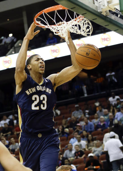 New Orleans Pelicans' Anthony Davis (23) dunks the ball against the Orlando Magic during the first half of an NBA preseason basketball game in Jacksonville, Fla., Wednesday, Oct. 9, 2013. (AP Photo/John Raoux)