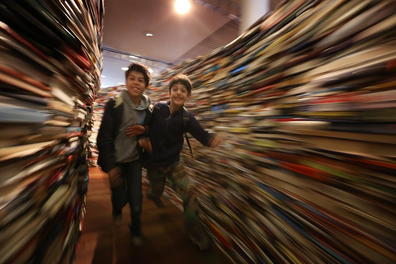 Children run in the 'aMAZEme' labyrinth made from books at The Southbank Centre on July 31, 2012 in London, England. (Photo by Peter Macdiarmid/Getty Images)