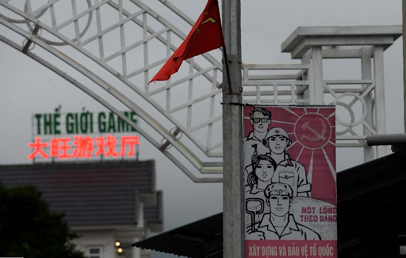 An official Vietnamese propaganda poster hangs in front of an entertainment centre in Ha Tinh province