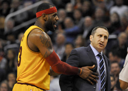 LeBron James pushed Cavs coach David Blatt out of the way to keep him from getting a technical. (USA Today)