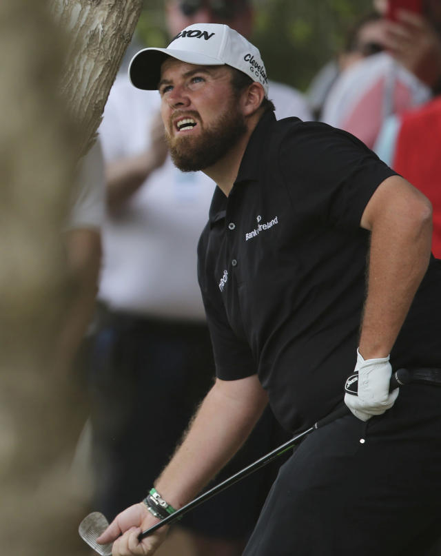 Shane Lowry of Ireland follows his ball on the 2nd hole in the final round of the Abu Dhabi Championship golf tournament in Abu Dhabi, United Arab Emirates, Saturday, Jan. 19, 2019. (AP Photo/Kamran Jebreili)