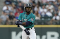 Seattle Mariners' Shed Long Jr. stands on second base after he hit a two-run double against the Los Angeles Angels during the fourth inning of a baseball game Friday, July 9, 2021, in Seattle. (AP Photo/Ted S. Warren)