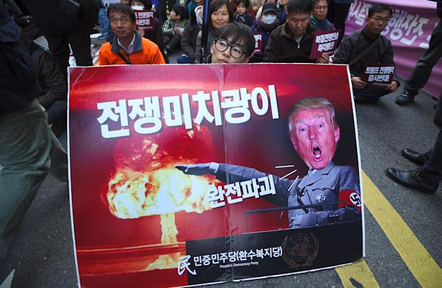 <p>A South Korean protestor holds a placard showing a picture of President Donald Trump during an anti-Trump rally in Seoul on Nov. 4, 2017, ahead of Trump's visit to South Korea. (Photo: Jung Yeon-Je/AFP/Getty Images) </p>
