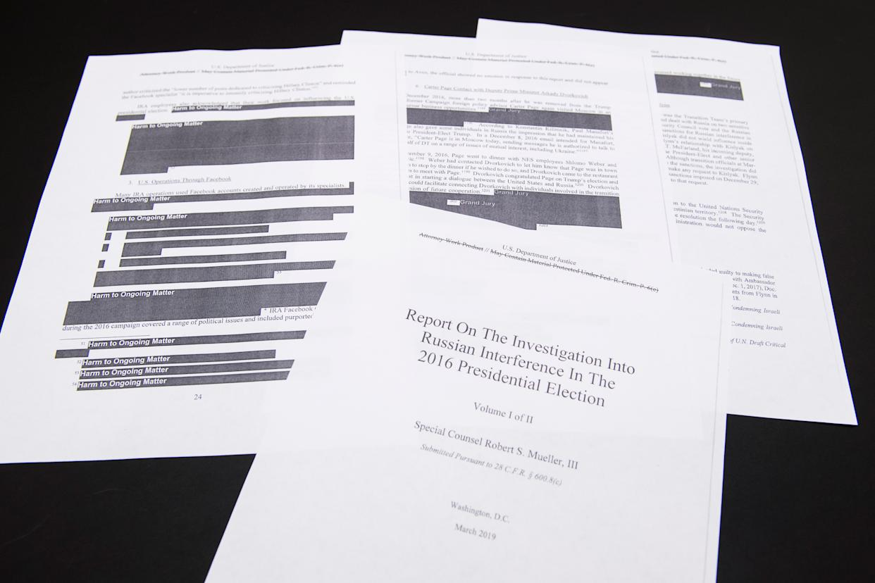 A few pages of Special Counsel Robert Mueller's report on Russian interference in the 2016 election that were printed out by staff in the House Judiciary Committee's hearing room on April 18, 2019. | Tom Williams—CQ Roll Call/Getty Images