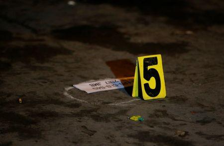 Police marking indicating fifth slug found on a crime scene after a man was killed, who police said was a drug related vigilante killing in Pasig, Metro Manila