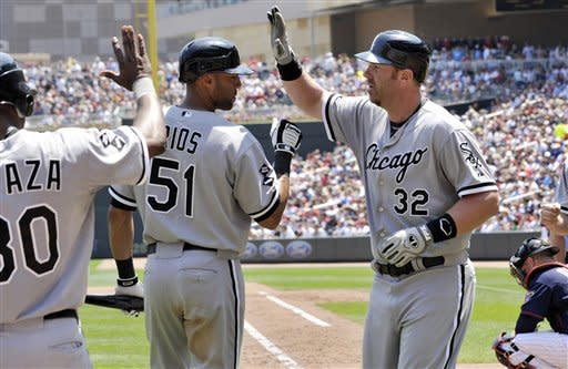 Chicago White Sox' Alex Rios (51) welcomes Adam Dunn after Dunn's three-run home run off Minnesota Twins pitcher Nick Blackburn in the fifth inning of a baseball game Wednesday, June 27, 2012 in Minneapolis. Rios, the on-deck batter, followed with a solo home run. (AP Photo/Jim Mone)