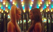 """This image released by A24 shows, Riley Keough, left, and Taylour Paige in a scene from """"Zola."""" (A24 via AP)"""