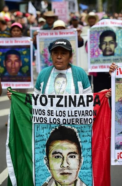 Fathers, relatives and people take part in a protest in Mexico city, on September 26, 2015, to commemorate the first anniversary of Ayotzinapa school students' disappearance (AFP Photo/Ronaldo Schemidt)