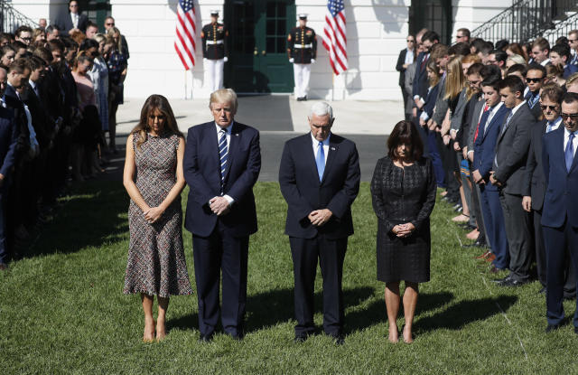 <p>U.S. President Donald Trump stands with first lady Melania Trump, Vice President Mike Pence and his wife Karen (R), as he leads a moment of silence in the wake of the the mass shooting in Las Vegas at the White House in Washington, U.S., October 2, 2017. (Photo: Kevin Lamarque/Reuters) </p>
