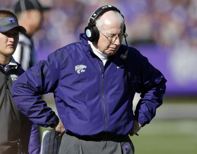 Kansas State coach Bill Snyder walks the sidelines during the first half of an NCAA college football game against West Virginia in Manhattan, Kan., Saturday, Oct. 26, 2013. (AP Photo/Orlin Wagner)