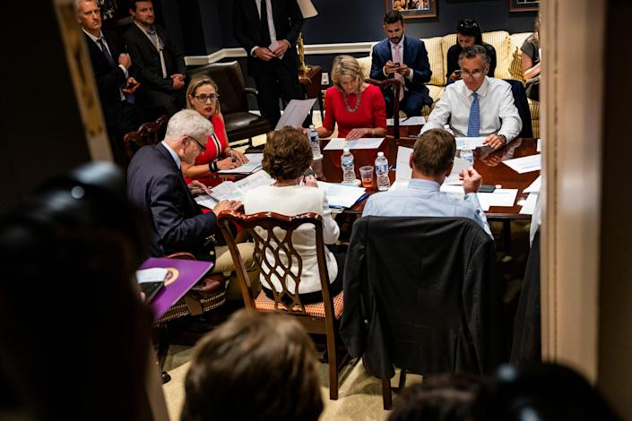 Sens. Bill Cassidy, R-La., Kyrsten Sinema, D-Ariz., Lisa Murkowski, R-Alaska, and Mitt Romney, R-Utah, hold a bipartisan meeting on infrastructure in the basement of the U.S. Capitol building after original talks fell through with the White House on June 8.
