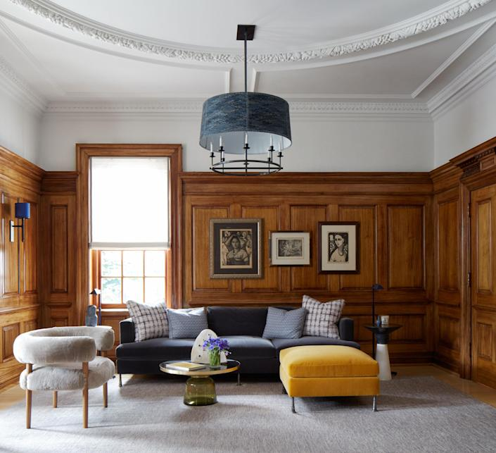 Under the guidance of an art historian, the mahogany panels in the library, which doubles as a home office, were fully stripped and French polished. Though it's filled with works by blue-chip artists (including Picasso and Matisse), the space maintains a relaxed, laid-back feel.