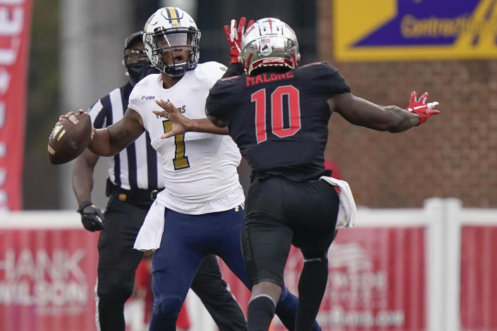 Western Kentucky defensive end DeAngelo Malone (10) pressures Florida International quarterback Kaylan Wiggins during the second half of an NCAA college football game Saturday, Nov. 21, 2020, in Bowling Green, Ky. (AP Photo/Bryan Woolston)