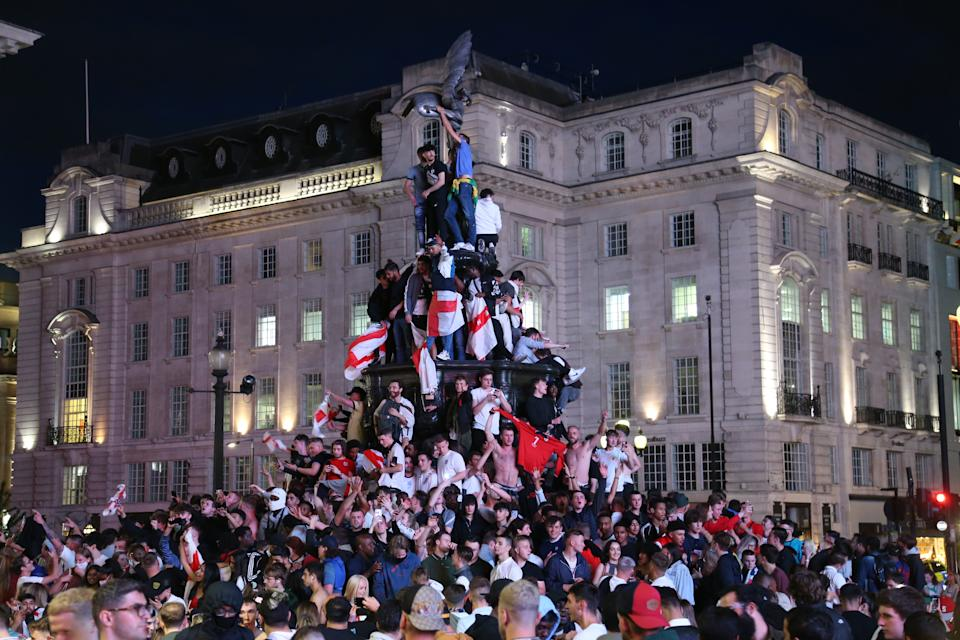 Fans of England celebrate after winning the UEFA EURO 2020 quarterfinal football match between Ukraine with 4-0, on July 3, 2021 in London, United Kingdom.