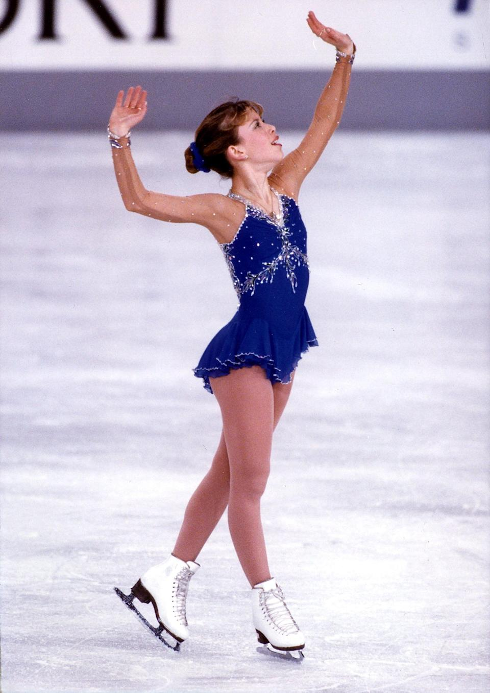 <p>Who can forget Tara Lipinski's cobalt blue embellished figure skating outfit, with intricate floral stitching and mesh sleeves stitched with rhinestones? She teamed it up with a blue scrunchie in the same shade for the 1998 Olympic winter games in Nagano, Japan, where she won gold and became the youngest gold medalist in women's figure skating.</p>