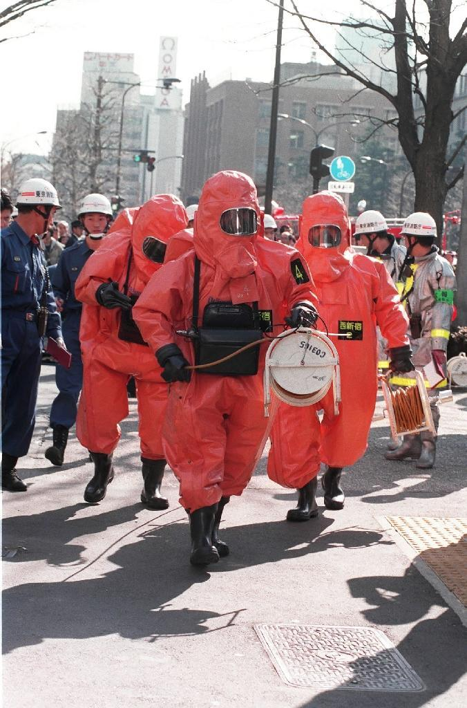 Officials dressed in protective suits and gas masks descended into the depths to help the injured and deal with the poison (AFP Photo/-)