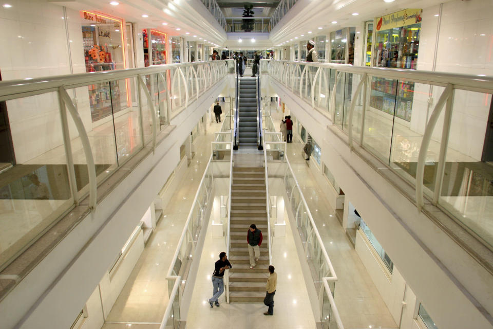 FILE -- In this Nov. 7, 2005 file photo, youth gather at the Kabul City Center mall in Kabul, Afghanistan. The Taliban fighters who rolled into Afghanistan's capital and other cities in recent days appear awestruck by the towering apartment blocks, modern office buildings and shopping malls. When the Taliban last seized power, in 1996, the country had been ravaged by civil war and the capital was in ruins. (AP Photo/Tomas Munita, File)