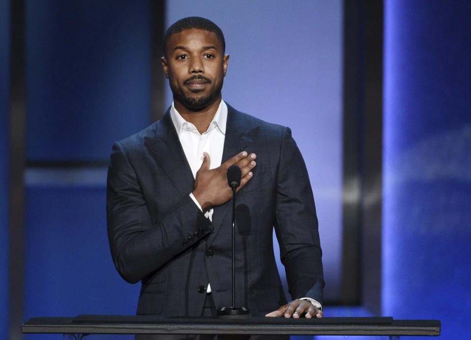 "FILE - Actor Michael B. Jordan pays tribute to actor Denzel Washington during the 47th AFI Life Achievement Award ceremony honoring Washington in Los Angeles on June 6, 2019. Jordan stars in the new film ""Tom Clancy's Without Remorse."" (Photo by Chris Pizzello/Invision/AP, File)"