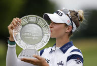 Nelly Korda kisses the trophy after winning the Meijer LPA Classic golf tournament, Sunday, June 20, 2021, in Grand Rapids, Mich. (AP Photo/Al Goldis)