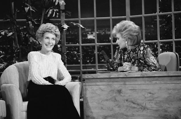 FILE - In this Oct. 30, 1986 file photo, talk show host Joan Rivers, right, talks with guest, first lady Nancy Reagan, during her appearance on The Late Show Starring Joan Rivers, on Fox TV. The role of female talk-show hosts in late-night TV network history, all 50-plus years of it, can be summed up in two words: Joan Rivers. It takes just another two _ Arsenio Hall _ to do the same for minorities. There's no indication that's going to change in the latest round of musical chairs involving Tonight and Late Night. (AP Photo, Reed Saxon, File)