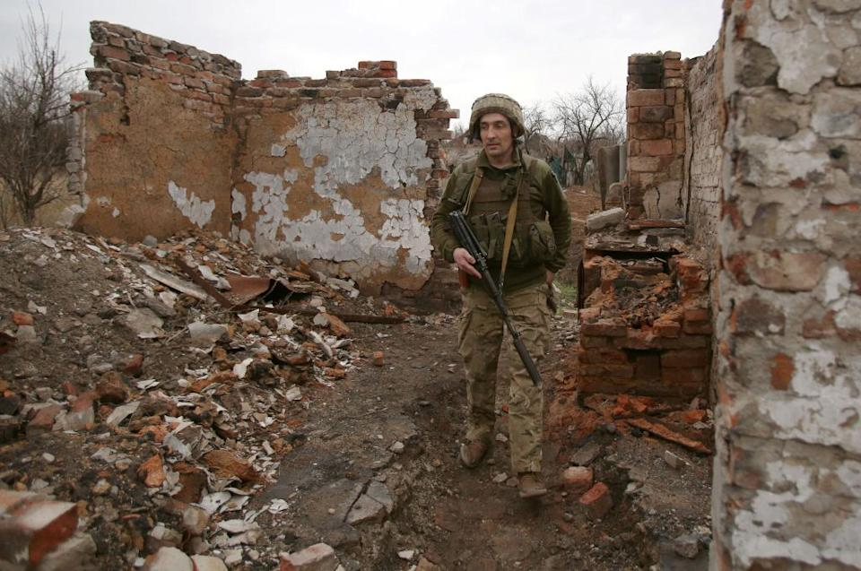 A serviceman from Ukraine near the frontline close to the small city of Marinka, Donetsk region on April 12.