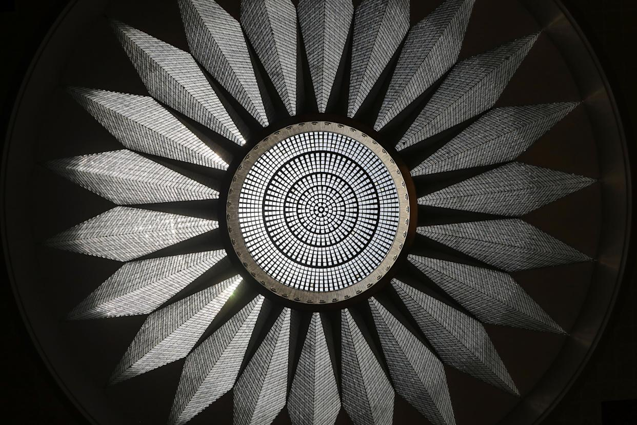 """A crystal chandelier hangs beneath a nineteen meter dome weighing more than nine tonnes in Yugoslavia saloon inside the The Palata Srbija building, Belgrade, Serbia. The Palata Srbija building hosted former world leaders. """"It is a shame to keep such a master piece away from the eyes of the public,"""" said Sandra Tesla, curator of the building. (Photo: Marko Djurica/Reuters)"""
