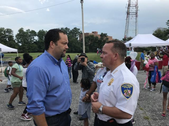 Ben Jealous, left, speaks with Baltimore Police Commissioner Kevin Davis during a community event designed to promote public safety and antiviolence measures (Photo: Andrew Bahl/Yahoo News)