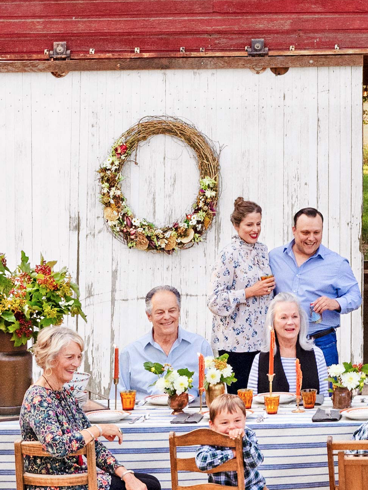 <p>Why settle for a small wreath when you can opt for a lush, oversized one? Dotted with dried fruits and faux flowers, this grapevine wreath would look lovely on your front door...but it'd also be the perfect addition to any outdoor dinner party. </p>