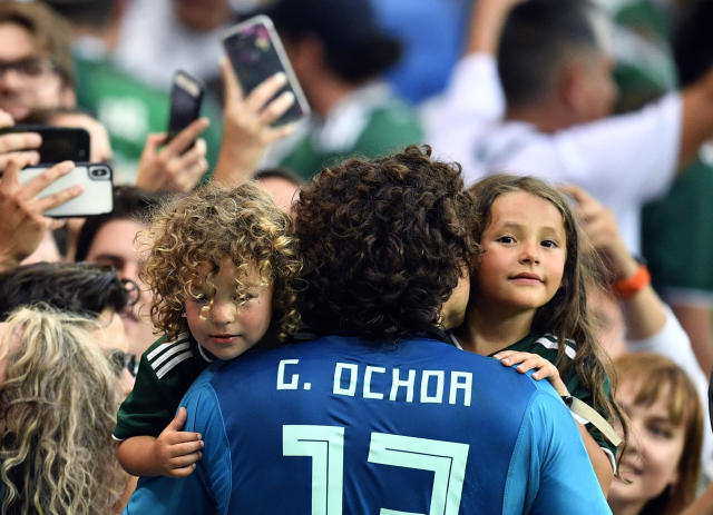 Mexico goalkeeper Guillermo Ochoa celebrates with family members at the end of the group F match between Mexico and South Korea at the 2018 soccer World Cup in the Rostov Arena in Rostov-on-Don, Russia, Saturday, June 23, 2018. (AP Photo/Martin Meissner)