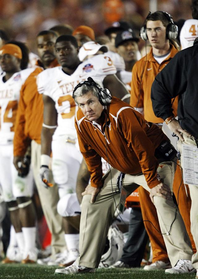 FILE - In this Jan. 7, 2010, file photo, Texas coach Mack Brown watches during the the fourth quarter of the BCS Championship NCAA college football game against Alabama in Pasadena, Calif. Brown has stepped down as coach and that the Alamo Bowl against Oregon on Dec. 30 will be his last game with the Longhorns, the school announced Saturday, Dec. 14, 2013. (AP Photo/ Marcio Jose Sanchez, File)