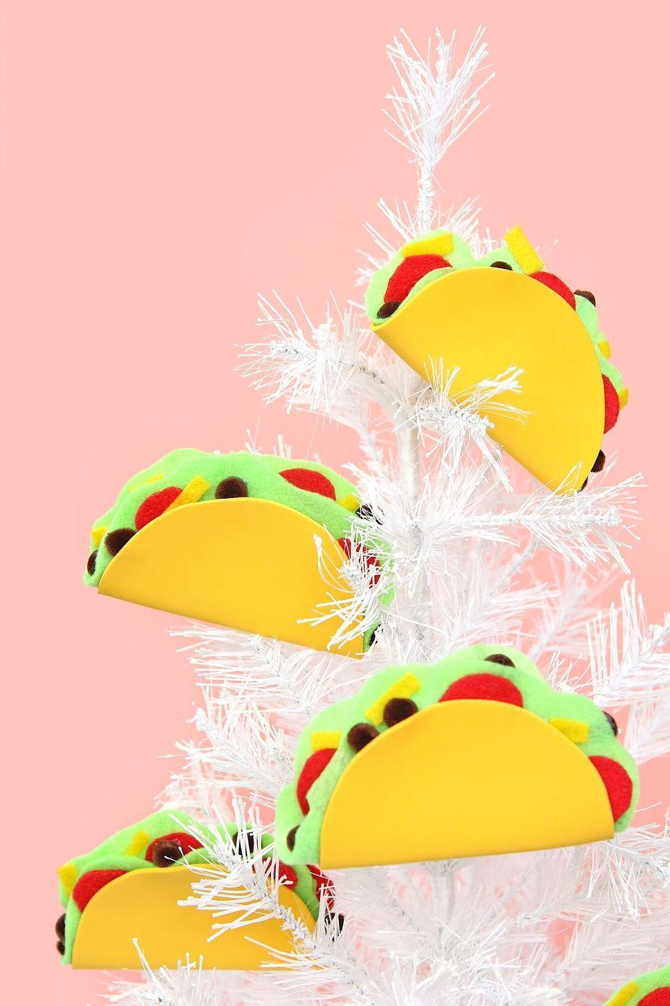 """<p>Who says you have to go traditional? Invest in a little felt to create this slightly out there, but super fun food-themed DIY ornament that makes the perfect quirky gift.</p><p><em>Get the tutorial at <a href=""""http://www.awwsam.com/2015/12/10-minute-diy-taco-holiday-ornaments.html"""" rel=""""nofollow noopener"""" target=""""_blank"""" data-ylk=""""slk:Aww Sam"""" class=""""link rapid-noclick-resp"""">Aww Sam</a>.</em></p><p><a class=""""link rapid-noclick-resp"""" href=""""https://www.amazon.com/gp/bestsellers/arts-crafts/1289531011/?tag=syn-yahoo-20&ascsubtag=%5Bartid%7C10072.g.34443405%5Bsrc%7Cyahoo-us"""" rel=""""nofollow noopener"""" target=""""_blank"""" data-ylk=""""slk:SHOP FELT"""">SHOP FELT</a></p>"""