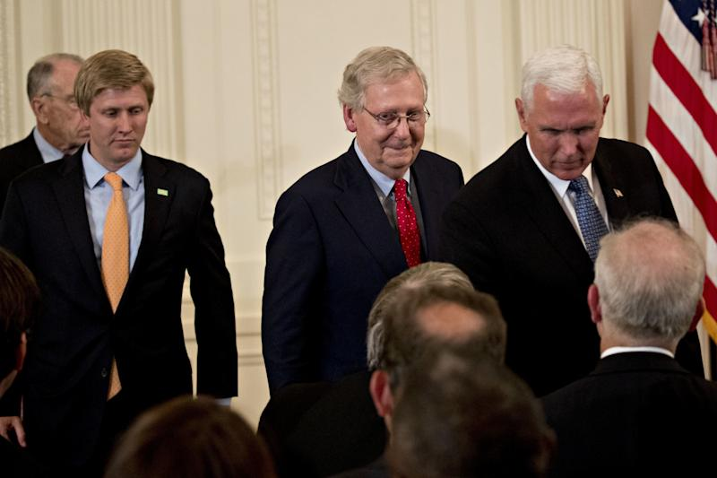 Senate Majority Leader Mitch McConnell and Vice President Mike Pence attend the U.S. Supreme Court nomination announcement ceremony in the East Room of the White House. (Bloomberg via Getty Images)