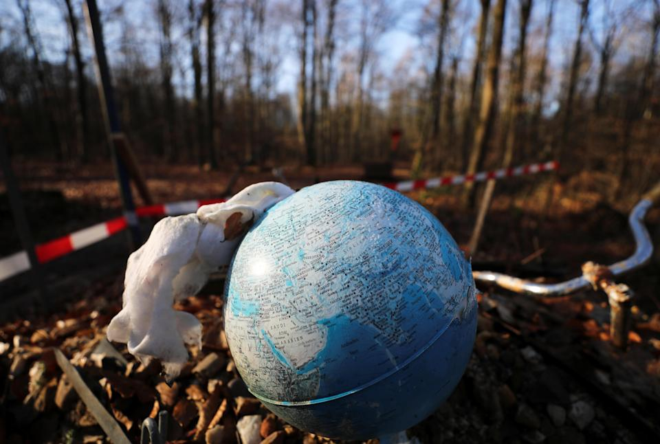 A Molotov cocktail is prepared in a globe in the Hambach Forest