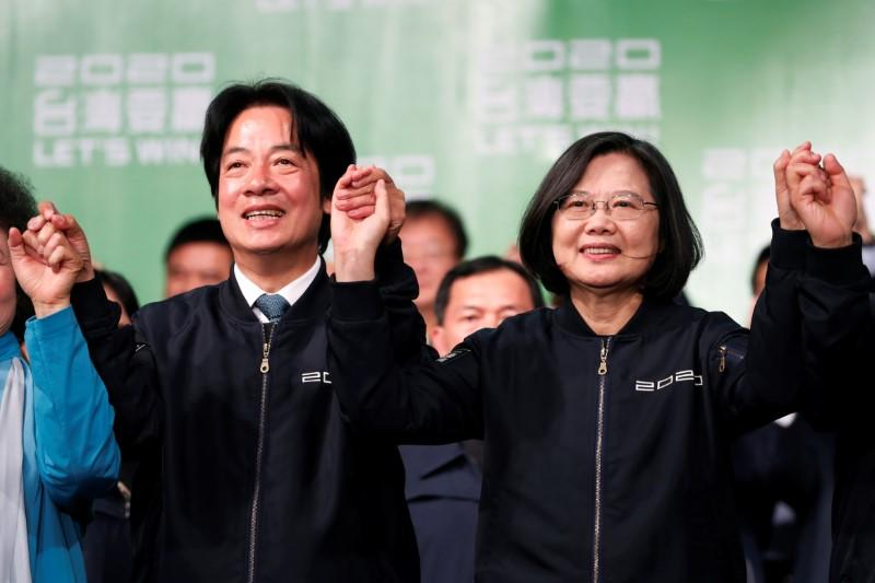 Taiwan Vice President-elect William Lai and incumbent Taiwan President Tsai Ing-wen celebrate at a rally after their election victory, outside the Democratic Progressive Party (DPP) headquarters in Taipei