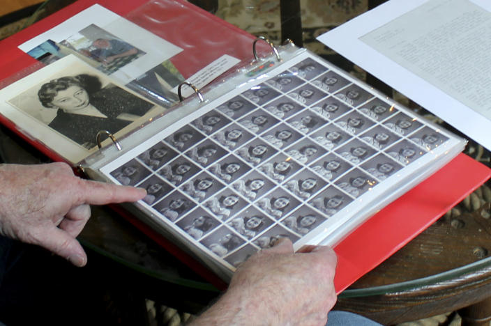 In this June 7, 2019 photo, Ryan Cooper shows photos of Anne Frank that he kept in a scrapbook at his home in Yarmouth, Mass. The 48 small images were made in a photo booth in 1940. Cooper has donated a trove of letters and mementos he received from her father, Otto Frank, to the U.S. Holocaust Memorial Museum ahead of the 90th anniversary of Anne Frank's birthday. (AP Photo/Philip Marcelo)